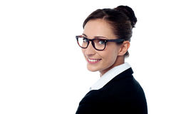 Business lady turning back with a smile Royalty Free Stock Image