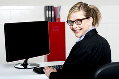 Business lady turning back and smiling at camera Stock Photos