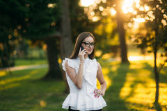 Business lady uses a tablet in the park during a break. Business woman in the park Stock Images