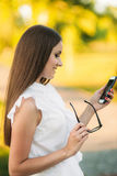 Business lady uses a tablet in the park during a break. Business woman in the park Stock Photo