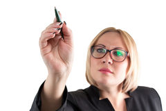 Business lady on white pointing at something Royalty Free Stock Image
