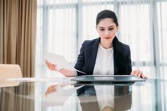 Business lady work manager documents office. Business lady at work. company manager. woman looking through documents in office. professional corporate dresscode Royalty Free Stock Photo