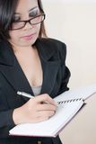 Business lady writing on the notebook for business Stock Image