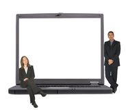 Business laptop with executive couple on it Royalty Free Stock Photography