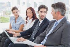 business laptop looking team Στοκ φωτογραφίες με δικαίωμα ελεύθερης χρήσης