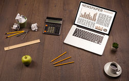 Business laptop with stock market report on wooden desk Royalty Free Stock Photo