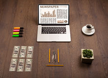 Business laptop with stock market report on wooden desk Stock Photography