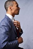 Business latin man. This picture represents a Latin business man checking his tie Stock Images