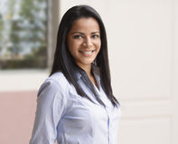 Business latin woman smiling royalty free stock photography