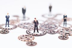 Business, law or political concept. Conceptual photo of gears and toy people. Business, law or political concept, which could represent decision making royalty free stock photography