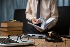 Business lawyer working hard at office desk workplace with book. And documents royalty free stock photography