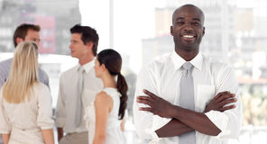 Business leader  with business team smiling Royalty Free Stock Photography