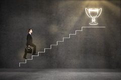 Business leader climbing ladder Stock Image