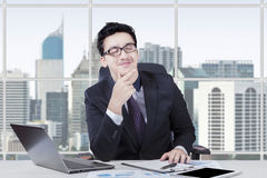 Business leader daydreaming at workplace Royalty Free Stock Photo