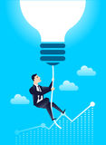 Business leader finance manager with  lightbulb idea, against the background of the chart of income.  Stock Photo