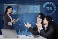 Business leader get applause from her partners. Young chinese businesswoman lead business meeting and get applause from her partners stock images