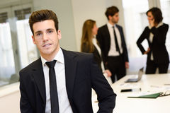 Business leader looking at camera in working environment Royalty Free Stock Images