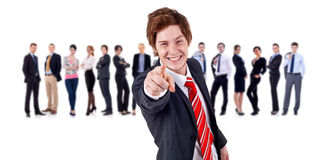 Business leader pointing. Business man and his team, leader is pointing at the camera isolated royalty free stock images