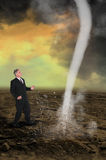 Business Leader Sales Profit Marketing. A businessman prepares to tackle a tornado storm funnel cloud. Business metaphor for leadership, being a leader, sales Royalty Free Stock Photo