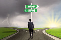 Business leader with signpost on the road Royalty Free Stock Images