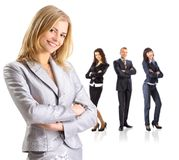Business leader standing in front of her team Stock Photography