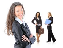 Business leader standing in front of her team Stock Photo