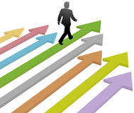 Business leader walks to progress future on arrow