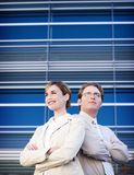Business leadership. Business man and woman standing side by side Stock Photos