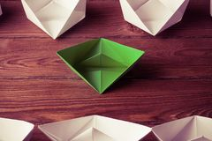 Business leadership concept with white and color paper boats on Royalty Free Stock Photo