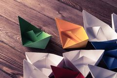 Business leadership concept with white and color paper boats on Stock Photography