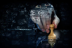 Business leadership strategy. Close up of man hand making chess move on dark background royalty free stock images