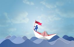 Business leadership and success concept, Businessman on top holding flag with sailing boat moving in a sea Royalty Free Stock Photo