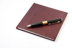 Business leather agenda with golden pen Stock Photography