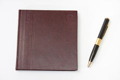 Business leather agenda with golden pen Royalty Free Stock Image
