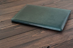 Business leather folder on the office desktop Stock Images