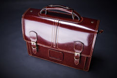 Business leather suitcase. Modern business leather suitcase (on a dark background Stock Photos