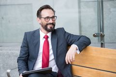 Free Business, Leisure, Technology, Communication And People Concept-man With Tablet On City Street Bench. Portrait Of Handsome Man Royalty Free Stock Photo - 118392845