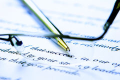 Business letter. With glasses and pen Stock Photography