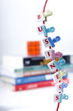Business Letter Pieces Clipped On a String Stock Photo