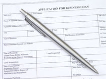 Business Loan Application. Application for business loan and pen stock photography