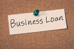 Business loan. Concept message on a cork board stock image