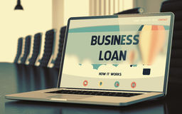 Business Loan on Laptop in Conference Hall. 3D. Modern Meeting Room with Laptop on Foreground Showing Landing Page with Text Business Loan. Closeup View. Toned stock photo