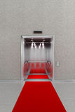 Open elevator with red carpet Royalty Free Stock Image
