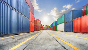 Business and logistics. Cargo transportation and storage. Equipment containers shipping and the traffic road with the yellow line. Perspective royalty free stock images
