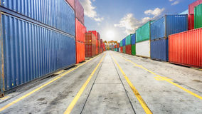 Business and logistics. Cargo transportation and storage. Equipment containers shipping and the traffic road with the yellow line. Perspective stock image