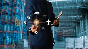 Businessman manager touching icon for logistics on Modern Trade warehouse