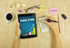 Business looking public polls rebranding on tablet . Stock Photos