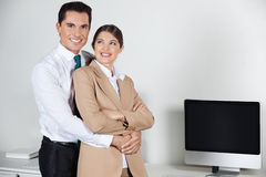 Business love affair in the office. With a manager and a secretary stock images