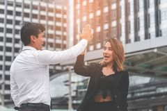 Business lover couple hi five for success in modern city stock images