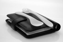 Business lunch. Isolated filofax with fork and spoon royalty free stock image